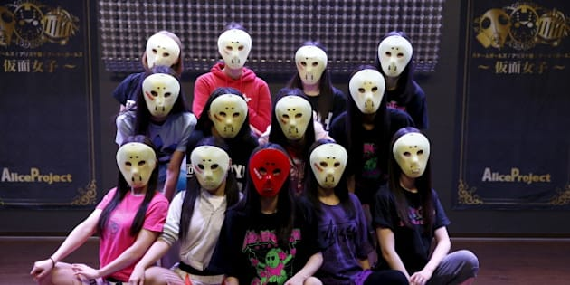 """Members of Japanese idol group Kamen Joshi (Masked Girls)  pose for a photo after a rehearsal for a concert at their theatre in Tokyo's Akihabara district, Japan March 17, 2016. For countless girl and pop-idol bands in Japan, standing out from the crowd can be daunting, but one group - """"Kamen Joshi"""" - seems to have found the answer by hiding behind masks. The Tokyo-based all female band has 18 members, split into three groups that perform across Japan and elsewhere in Asia. REUTERS/Toru Hanai SEARCH """"KAMEN JOSHI"""" FOR THIS STORY. SEARCH """"THE WIDER IMAGE"""" FOR ALL STORIES"""