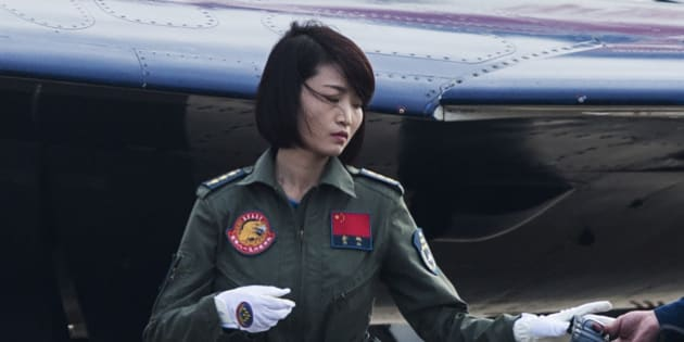 This picture taken on November 11, 2014 shows Chinese female J-10 fighter pilot Yu Xu getting ready to perform at the Airshow China in Zhuhai, south China's Guangdong province. The