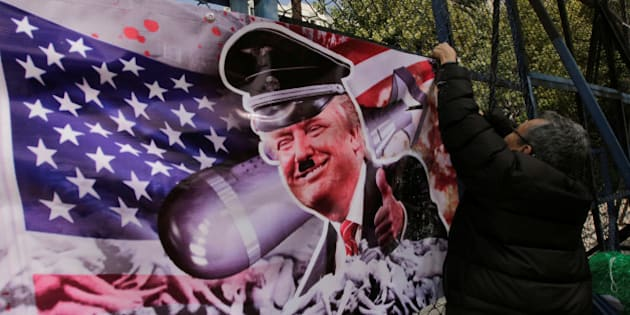 A demonstrator puts a banner with an image depicting U.S. President-elect Donald Trump as he takes part in a protest against Trump, outside the U.S. embassy in Mexico City, Mexico November 14, 2016. REUTERS/Henry Romero