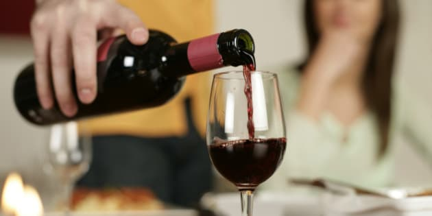 Man pouring red wine