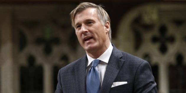 Canada's Minister of State for Small Business and Tourism Maxime Bernier speaks during Question Period in the House of Commons on Parliament Hill in Ottawa October 28, 2011.       REUTERS/Chris Wattie       (CANADA - Tags: POLITICS)