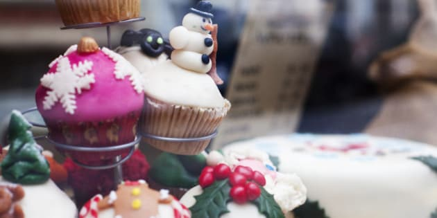 nice decorated Christmas muffins with a snowman on display in a shop