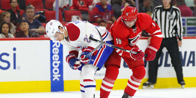 Nov 18, 2016; Raleigh, NC, USA;  Montreal Canadiens defensemen Nathan Beaulieu (28) battles for the puck with Carolina Hurricanes forward Elias Lindholm (16) during the second period at PNC Arena. Mandatory Credit: James Guillory-USA TODAY Sports
