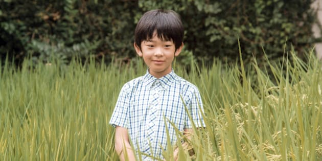 Japan's Prince Hisahito, the only son of Prince Akishino and Princess Kiko, poses at a rice field of the Akasaka Detached Palace in Tokyo, Japan  in this handout picture taken August 10, 2016, and provided by the Imperial Household Agency of Japan. Prince Hisahito turned 10 years old on September 6, 2016. Imperial Household Agency of Japan/Handout via Reuters/File photoATTENTION EDITORS - THIS PICTURE WAS PROVIDED BY A THIRD PARTY. FOR EDITORIAL USE ONLY. NOT FOR SALE FOR MARKETING OR ADVERTISING CAMPAIGNS