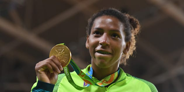 RIO DE JANEIRO, BRAZIL - AUGUST 08:  Rafaela Silva of Brazil celebrates after winning the gold medal in the Women's -57 kg Final - Gold Medal Contest on Day 3 of the Rio 2016 Olympic Games at Carioca Arena 2 on August 8, 2016 in Rio de Janeiro, Brazil.  (Photo by David Ramos/Getty Images)