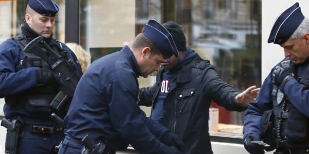 A troublemaker is arrested by French Police officers in front of the Bataclan concert hall in Paris, France, Sunday, Nov. 13, 2016 after a ceremony held for the victims of last year's Paris attacks which targeted the Bataclan concert hall as well as a series of bars and killed 130 people. (AP Photo/Francois Mori)