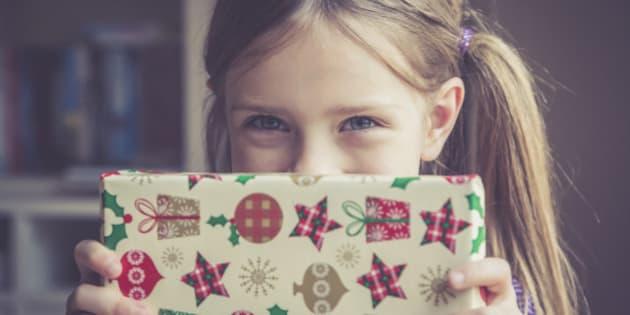 Little girl holding Christmas present