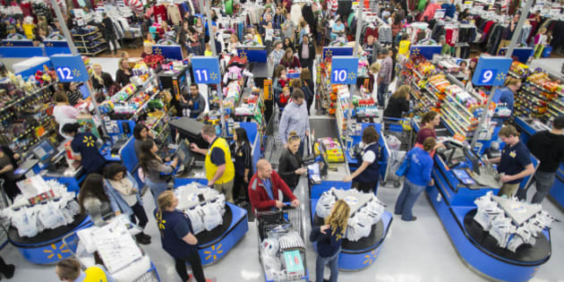 IMAGE DISTRIBUTED FOR WALMART - Customers leave happy from a Walmart store in Bentonville, AR, with their Black Friday items on Thursday, Nov. 24, 2016. This year, Walmart stocked its digital and physical aisles with more than 1.5 million televisions, nearly two million tablets and computers and three million video games. (Gunnar Rathbun/AP Images for Walmart)