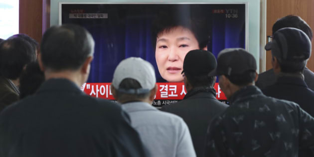 "People watch a TV screen showing the live broadcast of South Korean President Park Geun-hye's addressing to the nation, at the Seoul Railway Station in Seoul, South Korea, Friday, Nov. 4, 2016. Park took sole blame Friday for a ""heartbreaking"" scandal that threatens her government and vowed she will accept a direct investigation into her actions amid rising suspicion that she allowed a mysterious confidante to manipulate power from the shadows. (AP Photo/Lee Jin-man)"