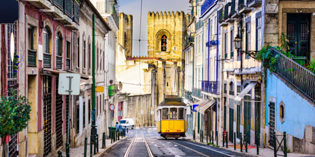 Lisbon, Porgugal cityscape and tram near Lisbon Cathedral.
