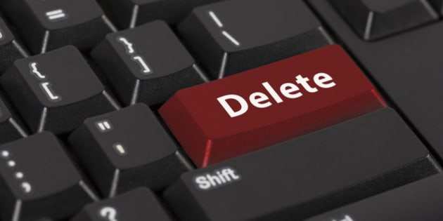 Keyboard with the word Delete on red button.