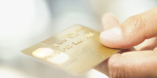 Close up of credit card in man's hand