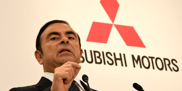 Nissan Motors chairman and CEO Carlos Ghosn answers a question during a joint press conference with Mitsubishi Motors Corporation (MMC) president and CEO Osamu Masuko in Tokyo on October 20, 2016.  Ghosn, the head of Japan's number two automaker Nissan, said on October 20 will become chairman of struggling Mitsubishi Motors, five months after throwing a lifeline to the scandal-hit firm.  / AFP / TOSHIFUMI KITAMURA        (Photo credit should read TOSHIFUMI KITAMURA/AFP/Getty Images)