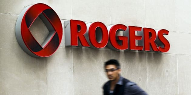 A man walks past a Rogers sign on the day of the Rogers Communications Inc. annual general meeting for shareholders in Toronto, April 21, 2015.    REUTERS/Mark Blinch