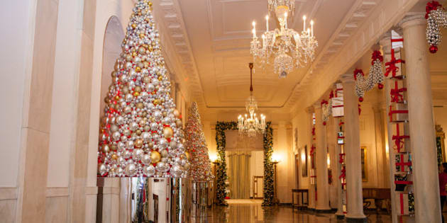 "In the Grand Foyer of the White House, the theme is: ""The Gift of Reflection"", featuring stacked columns of shiny presents, mirrored ornaments adorning the trees and garlands, for the 2016 holiday decor at the White House in Washington, DC, on November 29, 2016. (Photo by Cheriss May/NurPhoto via Getty Images)"