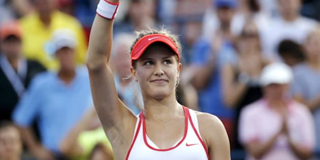 Eugenie Bouchard of Canada waves to the crowd after defeating Dominika Cibulkova of Slovakia in their women's singles third round match at the U.S. Open Championships tennis tournament in New York, September 4, 2015. REUTERS/Mike Segar