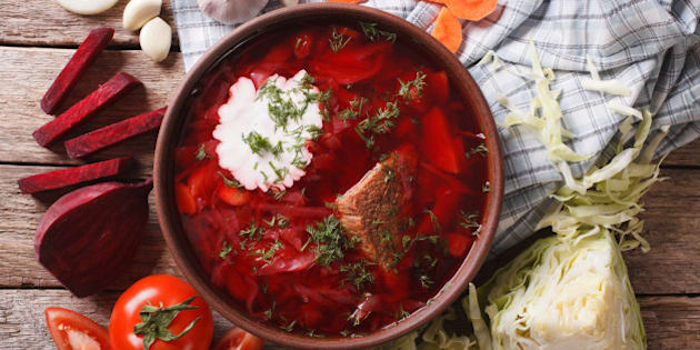 Ukrainian borsch soup and ingredients on the table close-up. Horizontal view from above