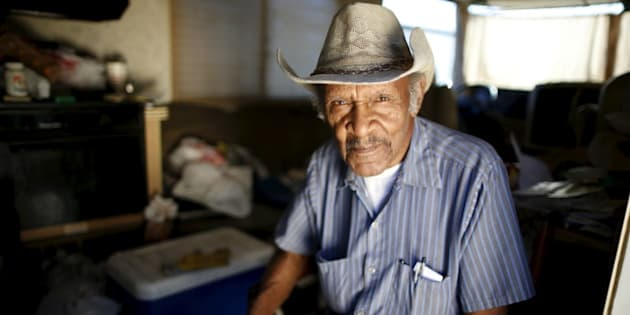 """Samuel Cole, 85, poses for a portrait in the motorhome in which he lives on the streets of Los Angeles, California, United States, November 12, 2015. Cole is a retired truck driver who began living in his motorhome two years ago when he couldn't afford the $100 rise in his rent. Los Angeles is grappling with a massive homelessness problem, as forecasted El Nino downpours threaten to add to the misery of thousands of people who sleep on the streets. Mayor Eric Garcetti has proposed spending $100 million to combat the problem in the sprawling metropolis but stopped short of declaring a state of emergency. REUTERS/Lucy Nicholson PICTURE 8 OF 17 - SEARCH """"NICHOLSON MOTORHOME"""" FOR ALL IMAGES   TPX IMAGES OF THE DAY"""