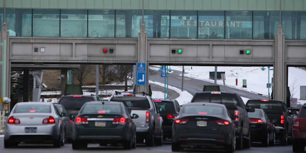 Vehicles make their way through the Canadian border crossing in Niagara Falls, Ontario, Canada, on Jan. 23, 2016. A 34 percent plunge in the Canadian dollar since 2011 is spurring a reversal of traffic along the longest undefended border in the world. Photographer: Cole Burston/Bloomberg via Getty Images