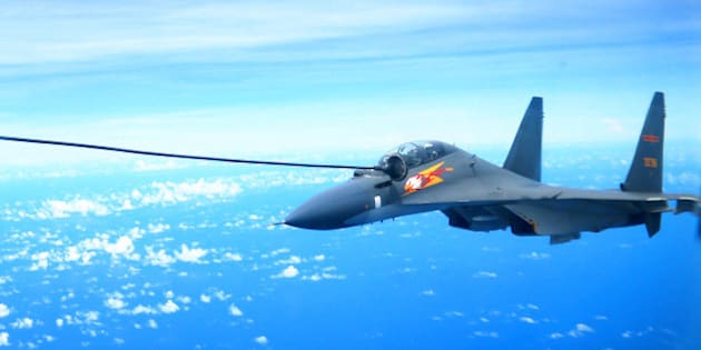 GUANGZHOU, Sept. 13, 2016  -- A Chinese Air Force Su-30 fighter is refueled during a routine combat simulation drill over the West Pacific Sept. 12, 2016. The Chinese Air Force on Monday sent multiple aircraft models, including H-6K bombers, Su-30 fighters, and air tankers, for the drill. The fleet conducted reconnaissance and early warning, sea surface cruising, inflight refueling, and achieved all the drill's targets. (Xinhua/Xiao Jianjun via Getty Images)