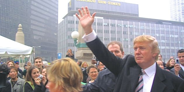 Chicago, IL, USA - October 28, 2004: An overcast afternoon view of real estate developer Donald Trump,  from Wacker Drive across the Chicago River toward the old Sun-Times Building, greeting onlookers prior to a public demolition event of that structure, which would make way for construction of the Trump International Hotel and Tower on that site.