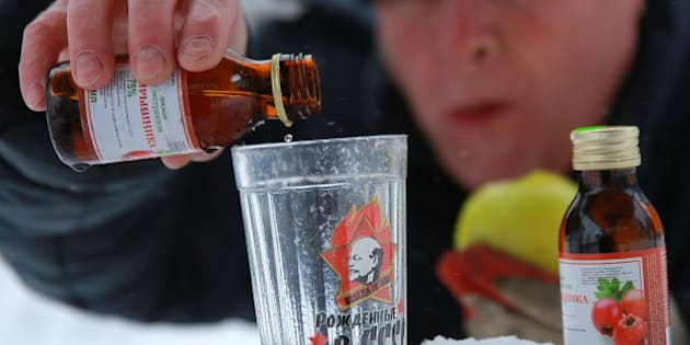 IVANOVO, RUSSIA - DECEMBER 19, 2016: A man pours Hawthorn infusion into a glass. The Russian Government demanded to withdraw the Hawthorn infusion and other alcohol containing products from retail after a deadly poisoning in Irkutsk. Vladimir Smirnov/TASS (Photo by Vladimir Smirnov\TASS via Getty Images)