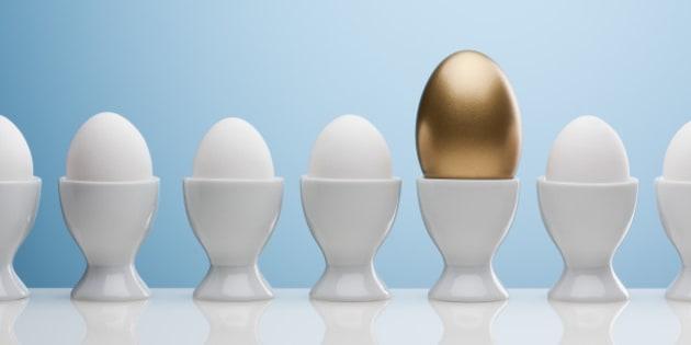 Golden egg in egg cup