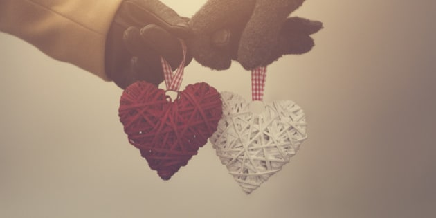 Couple in love holding hearts.
