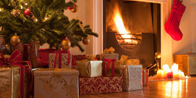 Christmas tree and stocking near fireplace