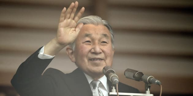 Japanese Emperor Akihito waves to well-wishers from the balcony of the Imperial Palace in Tokyo on December 23, 2015. Thousands of people gathered at the palace to celebrate Emperor Akihito's 82nd birthday.    AFP PHOTO / TOSHIFUMI KITAMURA / AFP / TOSHIFUMI KITAMURA        (Photo credit should read TOSHIFUMI KITAMURA/AFP/Getty Images)