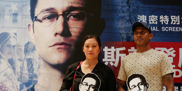 "Asylum seekers Vanessa Mae Bondalian Rodel, 42, from the Philippines, and Ajith Pushpakumara, 44, from Sri Lanka, who helped hiding Edward Snowden while he was in Hong Kong in 2013, attend a special screening of the film ""Snowden"" directed by Oliver Stone, in Hong Kong, China, September 30, 2016.      REUTERS/Bobby Yip"