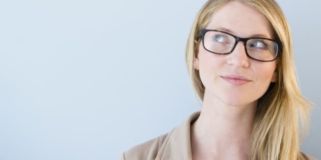 Woman wearing glasses looking up