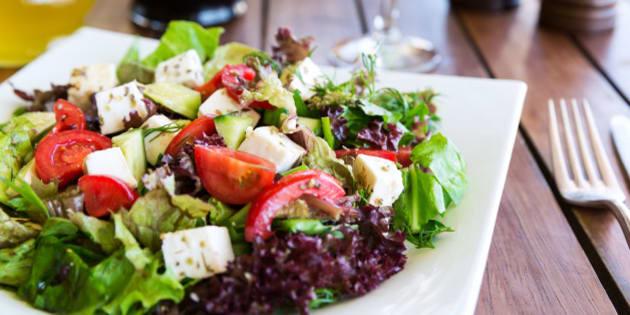 Greek Mediterranean salad with feta cheese, tomatoes and peppers. Mediterranean salad. Mediterranean cuisine. Greek cuisine.