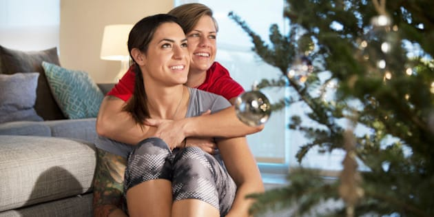 Lesbian couple embracing at christmas.