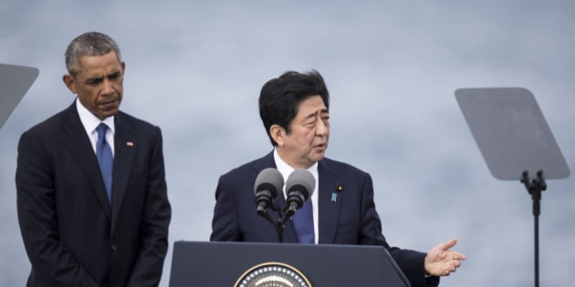 HONOLULU, HI - DECEMBER 27: U.S. President Barack Obama listens while Japanese Prime Minister Shinzo Abe delivers remarks at Joint Base Pearl Harbor Hickam's Kilo Pier on December 27, 2016 in Honolulu, Hawaii. Abe is the first Japanese prime minister to visit Pearl Harbor with a U.S. president and the first to visit the USS Arizona Memorial.  (Photo by Kent Nishimura/Getty Images)