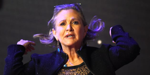 Carrie Fisher poses for cameras as she arrives at the European Premiere of Star Wars, The Force Awakens in Leicester Square, London, December 16, 2015.      REUTERS/Dylan Martinez