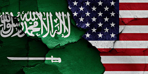 flags of Saudi Arabia and USA painted on cracked wall