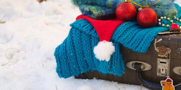 Winter vacation suitcase.Travel tips