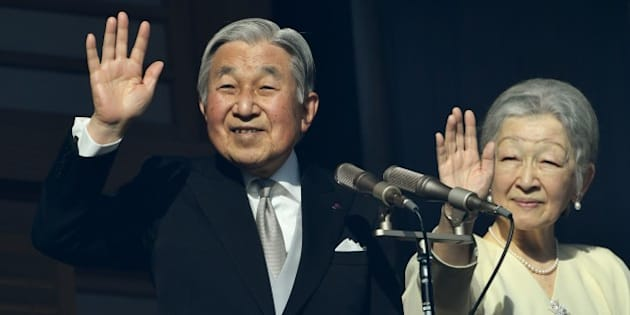 Japanese Emperor Akihito (L) and Empress Michiko (R) wave to well-wishers on the balcony of the Imperial Palace in Tokyo on January 2, 2017.