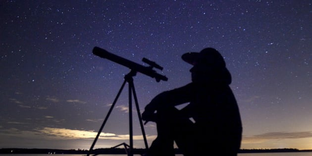 A stargazer waits for the Perseid meteor shower to begin near Bobcaygeon, Ontario, August 12, 2015. Picture taken August 12, 2015. REUTERS/Fred Thornhill TPX IMAGES OF THE DAY