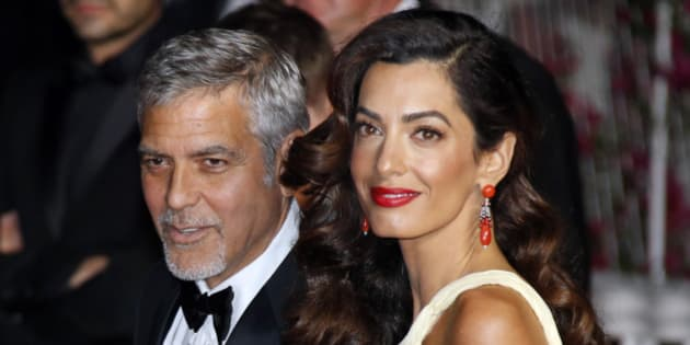 """Cast member George Clooney and his wife Amal leave the Festival Palace after the screening of the film """"Money Monster"""" out of competition at the 69th Cannes Film Festival in Cannes, France, May 12, 2016.  REUTERS/Jean-Paul Pelissier"""