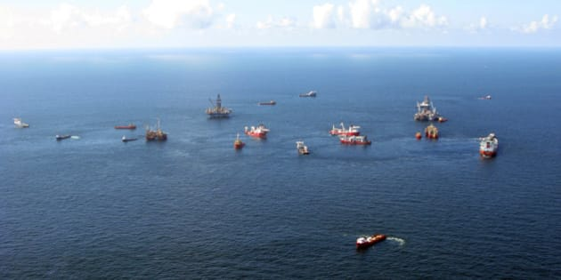 "Preparations to drill a relief well continue at the Macondo oil spill site in the Gulf of Mexico, in this aerial photograph taken from a coast guard helicopter on August 21, 2010. Scientists above U.S. research ship Pisces (not pictured) have started an around-the-clock search for elusive signs of oil lurking beneath the Gulf of Mexico's surface in what they jokingly call ""Operation Dipstick."" Picture taken August 21, 2010. REUTERS/Ann Driver (UNITED STATES - Tags: ENERGY ENVIRONMENT DISASTER BUSINESS)"