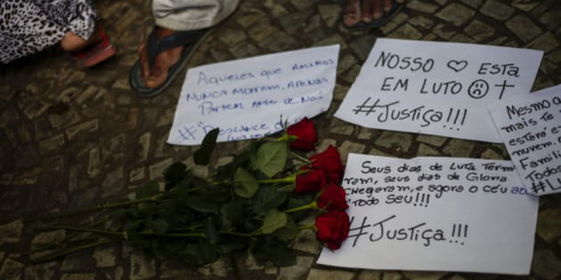 View of signs on the floor during a protest against homophobia at Dom Pedro II station in Sao Paulo, Brazil, on December 30, 2016, after street vendor Luiz Carlos Ruas was beaten to death at the metro station after trying to prevent a homeless transsexual being attacked by two unidentified men.  / AFP / Miguel SCHINCARIOL        (Photo credit should read MIGUEL SCHINCARIOL/AFP/Getty Images)