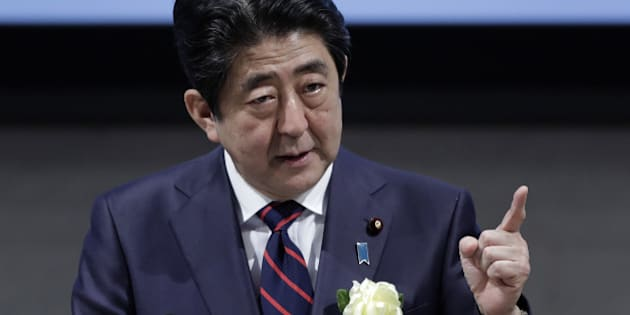 Shinzo Abe, Japan's prime minister, gestures as he speaks at business federation Nippon Keidanren in Tokyo, Japan on Monday, Dec. 26, 2016. During the meeting, Bank of Japan Governor Haruhiko Kuroda said that it's necessary to achieve 2 percent inflation in this round of monetary easing to ensure Japan never falls back into deflation. Photographer: Kiyoshi Ota/Bloomberg via Getty Images