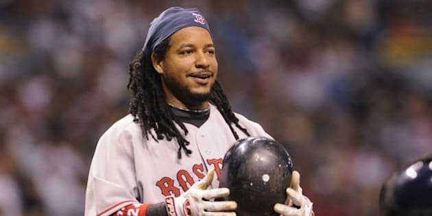 ST PETERSBURG, FL - July 2: Designated hitter Manny Ramirez #24 of the Boston Red Sox smiles after ducking from an inside pitch  against the Tampa Bay Rays July 2, 2008 at Tropicana Field in St. Petersburg, Florida.  (Photo by Al Messerschmidt/Getty Images)