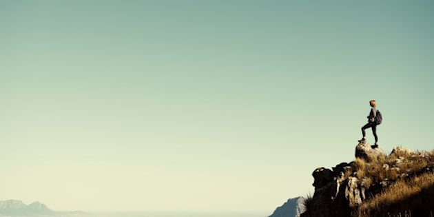 Shot of a young hiker taking in the view from the top of a mountainhttp://195.154.178.81/DATA/i_collage/pu/shoots/804697.jpg