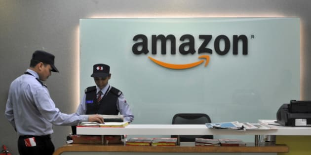 Security guards stand at the reception desk of the Amazon India office in Bengaluru, India, August 14, 2015. E-commerce giant Amazon.com is taking lessons learnt from its daily battles with India's choked roads and cramped cities to some of its largest developed markets, exporting a model of cheaper deliveries and reduced warehousing costs. Picture taken August 14, 2015. To match AMAZON.COM-INDIA/LOGISTICS REUTERS/Abhishek N. Chinnappa
