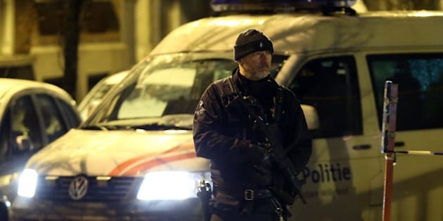 BRUSSELS, BELGIUM - JANUARY 14: A police officer stands guard during searches at Molenbeek district as part of an anti-terror operations in Brussels, Belgium on January 14, 2017.  (Photo by Dursun Aydemir/Anadolu Agency/Getty Images)