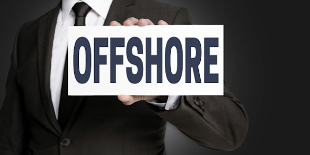 offshore sign is held by businessman.
