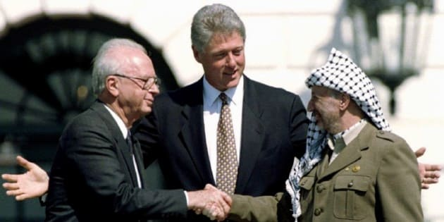U.S. President Bill Clinton (C) looks on as Israeli Prime Minister Yitzhak Rabin (L) and Palestine Liberation Organization (PLO) leader Yasser Arafat shake hands after the signing of the Israeli-PLO peace accord at the White House in this September 13, 1993 file photo.   REUTERS/Gary Hershorn/Files  (UNITED STATES - Tags: POLITICS TPX IMAGES OF THE DAY)  ATTENTION EDITORS - THIS PICTURE IS PART OF PACKAGE '30 YEARS OF REUTERS PICTURES'  TO FIND ALL 56 IMAGES SEARCH '30 YEARS'
